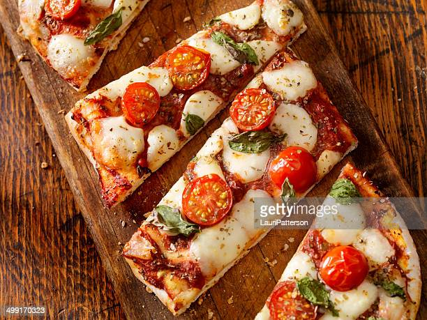 margherita flat bread pizza - serving size stock photos and pictures