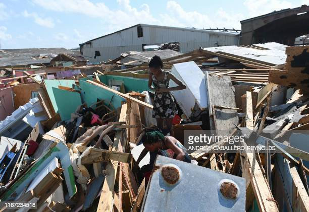 Margie Gerthadauphin and her daughter Kimberly looks over her destroyed home as she tries to salvage any belongings in Marsh Harbour Bahamas on...