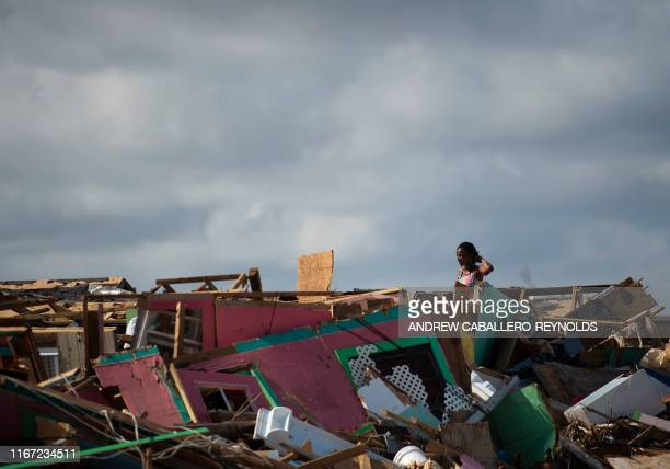 Margie Gerthadauphin looks over her destroyed home as she tries to salvage any belongings in Marsh Harbour Bahamas on September 10 one week after...
