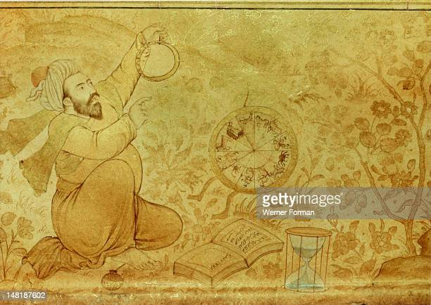 A margin drawing from the folio of Jahangir's Album An astrologer surrounded by his equipment astrolabe zodiac tables and an hour glass India Moghul...