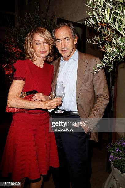 Margit Friedrich and Rene de Castro attend the OLIVEDA Launch Party at Bayerischer Hof on October 15 2013 in Munich Germany