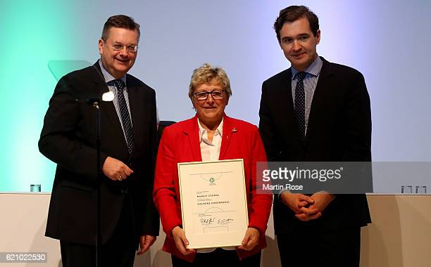 Margit Stoppa is honored with the DFB honorary merit by DFB president Reinhard Grindel and DFB General Secretary Dr Friedrich Curtius on November 4...