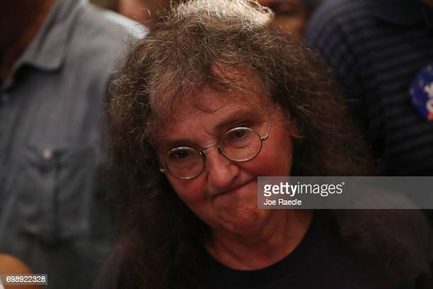 Margitta Rose reacts as vote results show Democratic candidate Jon Ossoff losing to his challengre during his election night party being held at the...