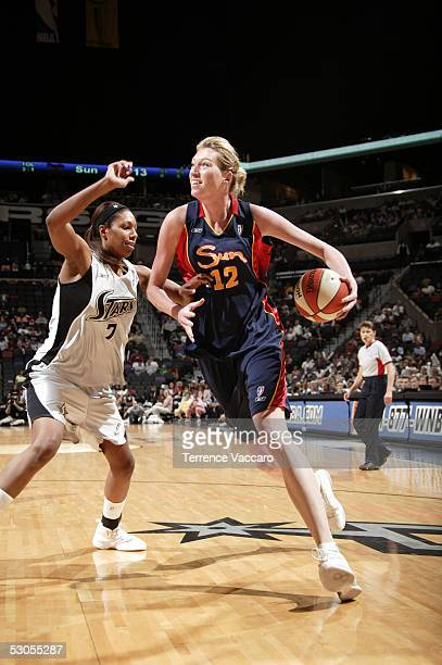 Margo Dydek of the Connecticut Sun drives against Chantelle Anderson of the San Antonio Silver Stars during the WNBA game at the SBC Center on June...