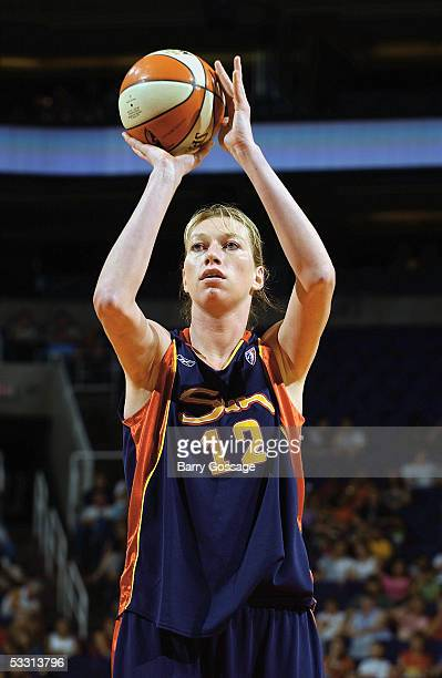 Margo Dydek of the Connecticut Sun shoots a free throw against the Phoenix Mercury during a WNBA game played on June 25 2005 at America West Arena in...