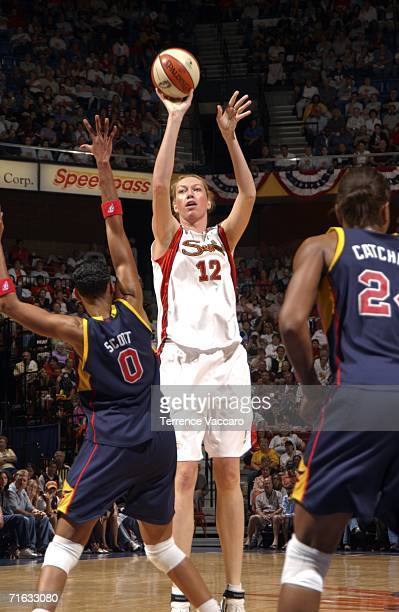 Margo Dydek of the Connecticut Sun shoots against Olympia Scott of the Indiana Fever on August 11, 2006 at Mohegan Sun Arena in Uncasville...
