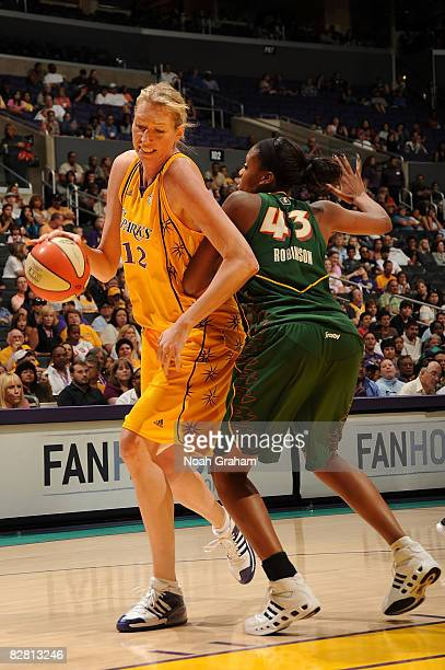 Margo Dydek of the Los Angeles Sparks takes the ball to the basket against Ashley Robinson of the Seattle Storm on September 14, 2008 at Staples...