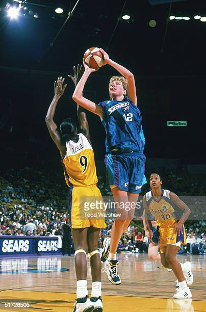 Margo Dydek of the San Antonio Silver Stars goes for the jump shot against Lisa Leslie of the Los Angeles Sparks during a game on July 2 1998 at the...