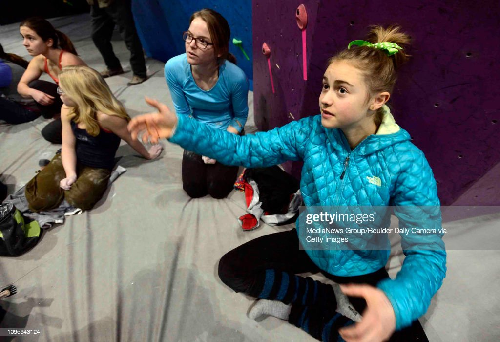 Margo Hayes, right, gets advice from professional climber