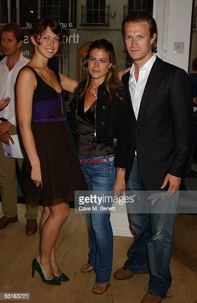 Margo Stilley Francesca Versace and Nick Saunders attend the Private View for The Sixties Set An Inside View By Robin DouglasHome at The Air Gallery...