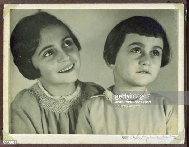 Margot and Anne Frank wearing smock dresses in a portrait This photo was taken from Margot's photo album
