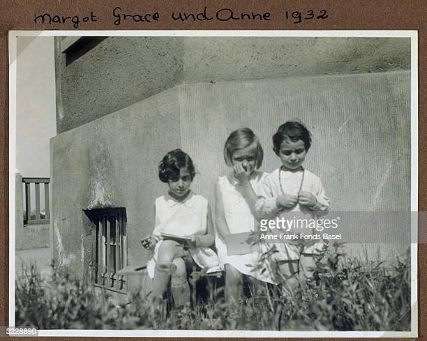 Margot Frank and Anne Frank with their friend Grace outside their home This photo was taken from Margot's photo album Frankfurt Germany