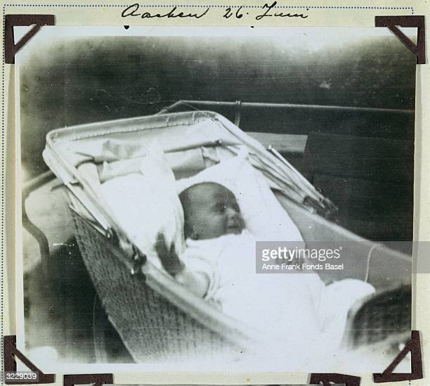 Margot Frank laughs in her bassinet in a snapshot taken from her photo album Aachen Germany