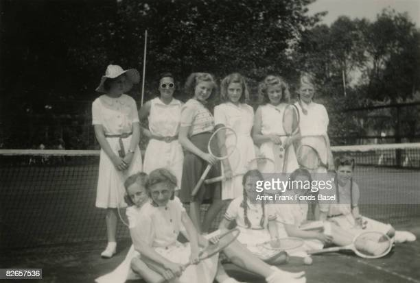 Margot Frank sister of Anne Frank on a tennis court in Amsterdam with a group of friends circa 1941