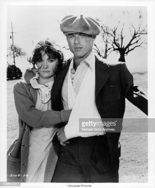 Margot Kidder and Robert Redford stand together in a scene from the film 'The Great Waldo Pepper' 1975