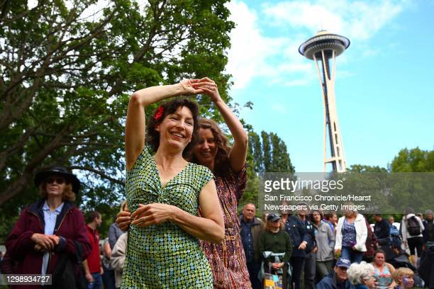 Margot Richardson and Julia Tobin dance to the music of Wylie and the Wild West during the 2016 Northwest Folklife Festival at Seattle Center, May...