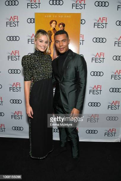 Margot Robbie and Ismael Cruz Cordova attend the closing night world premiere gala screening of Mary Queen Of Scots during AFI FEST 2018 presented by...