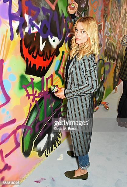 Margot Robbie and the cast of 'Suicide Squad' put the finishing touches on Graffiti artist Ryan Meades' mural ahead of tomorrow's film release on...
