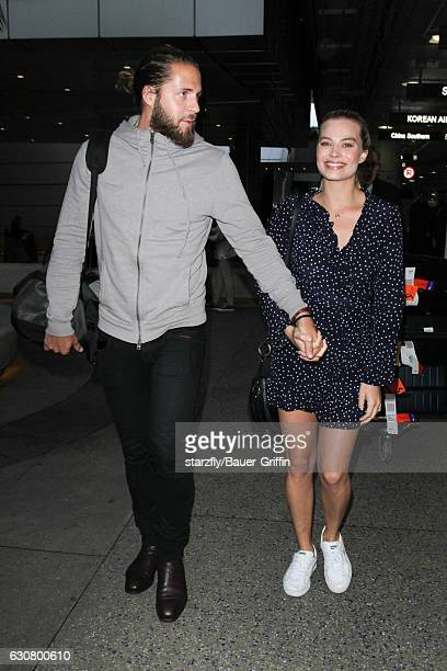 Margot Robbie and Tom Ackerley are seen at LAX on January 02 2017 in Los Angeles California