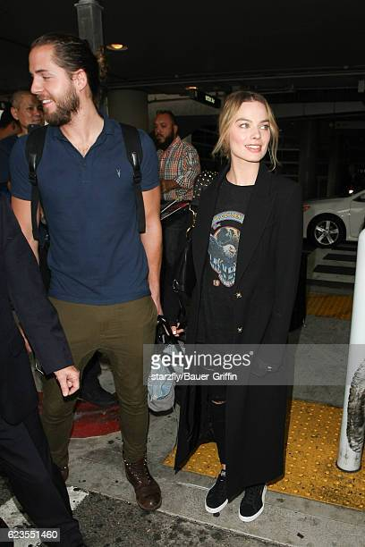 Margot Robbie and Tom Akerley are seen at LAX on November 15 2016 in Los Angeles California