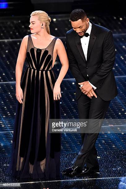Margot Robbie and Will Smith attend the closing night of 65th Festival di Sanremo 2015 at Teatro Ariston on February 14, 2015 in Sanremo, Italy.