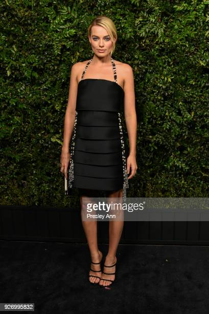 Margot Robbie attends Charles Finch And Chanel PreOscar Awards Dinner At Madeo in Beverly Hills at Madeo Restaurant on March 3 2018 in Los Angeles...