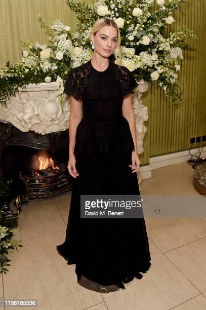 Margot Robbie attends the British Vogue and Tiffany & Co. Fashion and Film Party at Annabel's on February 2, 2020 in London, England.