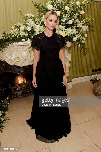 Margot Robbie attends the British Vogue and Tiffany Co Fashion and Film Party at Annabel's on February 2 2020 in London England