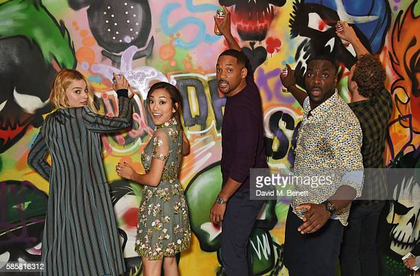 """Margot Robbie, Karen Fukuhara, Will Smith, Adewale Akinnuoye-Agbaje, Jai Courtney and the cast of """"Suicide Squad"""" put the finishing touches on..."""