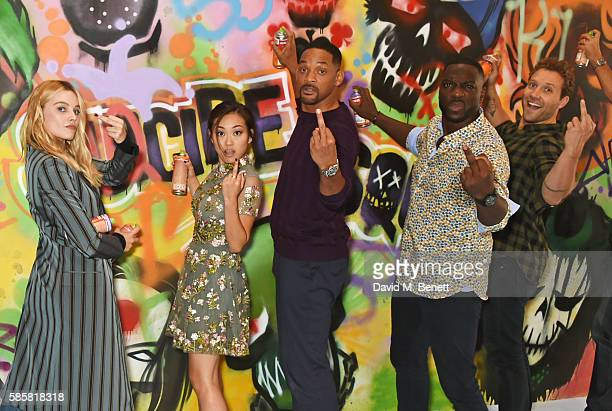"Margot Robbie, Karen Fukuhara, Will Smith, Adewale Akinnuoye-Agbaje, Jai Courtney and the cast of ""Suicide Squad"" put the finishing touches on..."