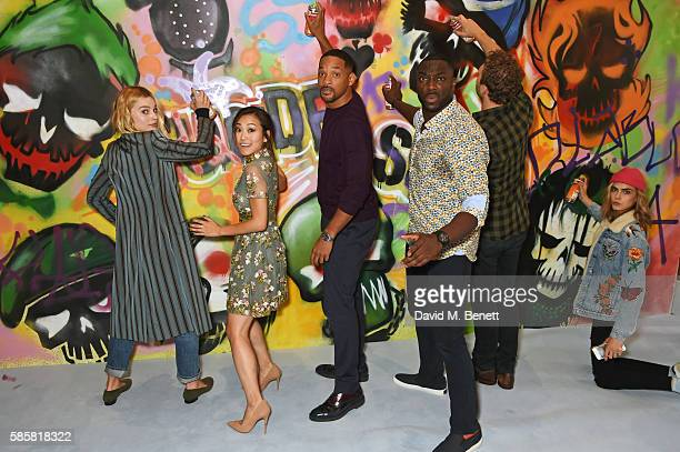 Margot Robbie Karen Fukuhara Will Smith Adewale AkinnuoyeAgbaje Jai Courtney Cara Delevingne and the cast of 'Suicide Squad' put the finishing...