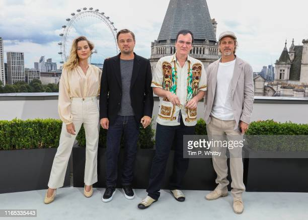 Margot Robbie Leonardo DiCaprio Quentin Tarantino and Brad Pitt attend the Once Upon A Time…In Hollywood Photocall in London at The Corinthia Hotel...