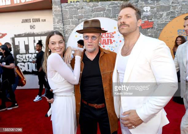 """Margot Robbie, Michael Rooker, and Jai Courtney attend the Warner Bros. Premiere of """"The Suicide Squad"""" at Regency Village Theatre on August 02, 2021..."""
