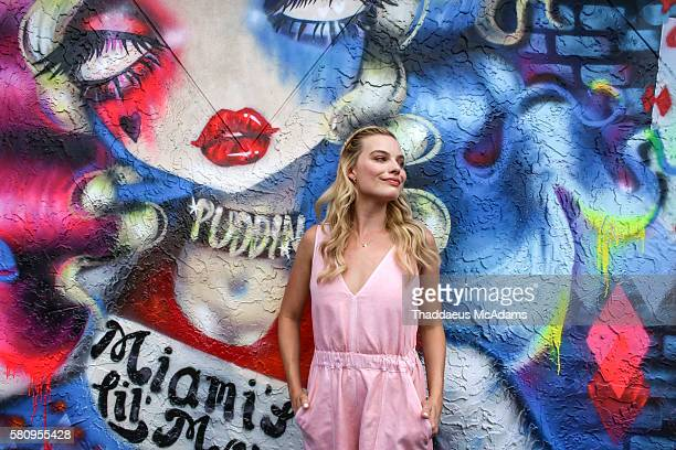 Margot Robbie poses in front of the mural at the 'Suicide Squad' Wynwood Block Party and mural reveal with the cast on July 25 2016 in Miami Florida