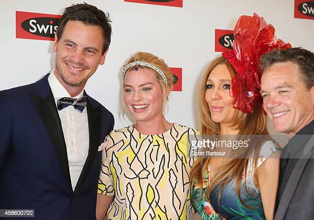 Margot Robbie poses with former Neighbours actors Alan Fletcher Totti Goldsmith Stefan Dennis and Dan OConnor at the Swisse Marquee on Stakes Day at...