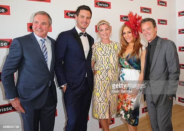 Margot Robbie poses with former Neighbours actors Alan Fletcher, Totti Goldsmith, Stefan Dennis and Dan OConnor at the Swisse Marquee on Stakes Day...