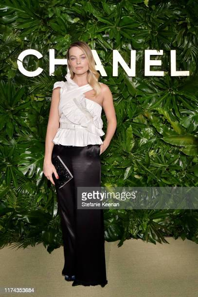 Margot Robbie, wearing CHANEL attends Chanel Dinner Celebrating Gabrielle Chanel Essence with Margot Robbie on September 12, 2019 in Los Angeles,...