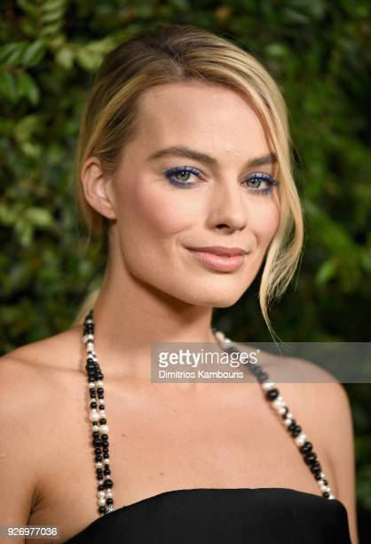 Margot Robbie wearing CHANEL attends Charles Finch and Chanel PreOscar Awards Dinner at Madeo in Beverly Hills on March 3 2018 in Beverly Hills...