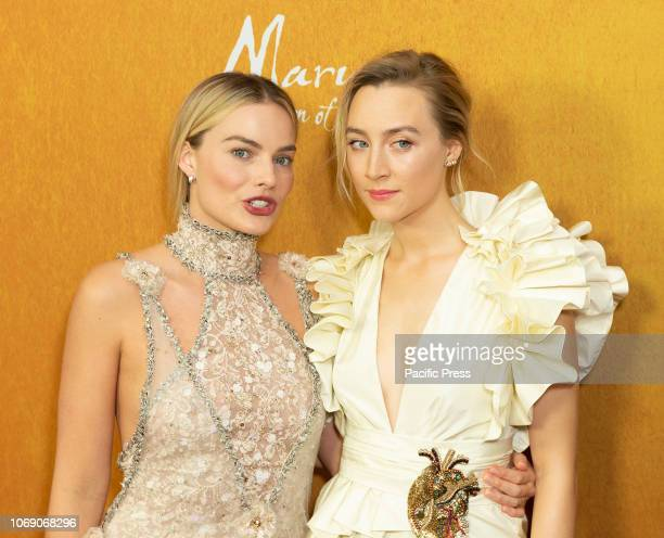 Margot Robbie wearing dress by Chanel Saoirse Ronan wearing dress by Gucci attend the New York premiere of 'Mary Queen Of Scots' at Paris Theater