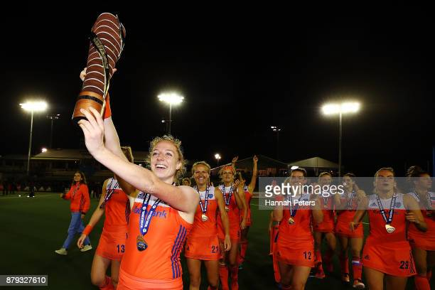 Margot van Geffen of the Netherlands celebrates with the trophy after winning the Hockey World League final between New Zealand and Netherlands at...