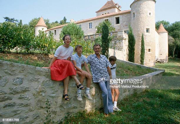 Margrethe II Queen of Denmark her husband Henrik and their two sons Frederik and Joachim sit outside of their chateau while vacationing in Caix France