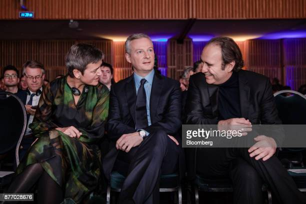 Margrethe Vestager competition commissioner of the European Commission left speaks with Xavier Niel billionaire and deputy chairman of Iliad SA right...