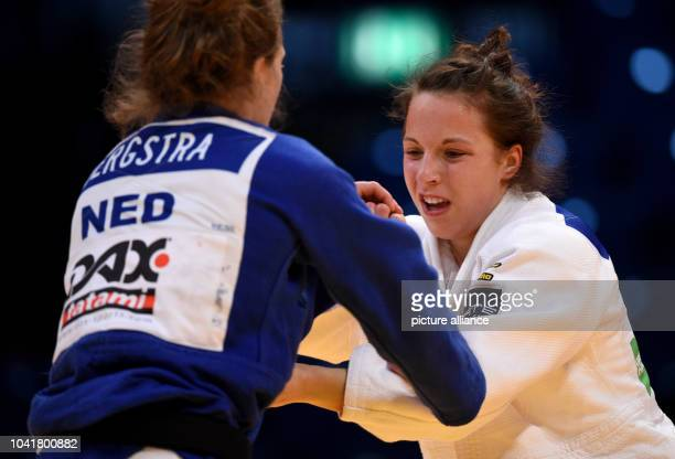 Margriet Bergstra and Amelie Stoll in action during the Judo Grand Prix at the Mitsubishi Electric Halle in Duesseldorf Germany 24 February 2017...