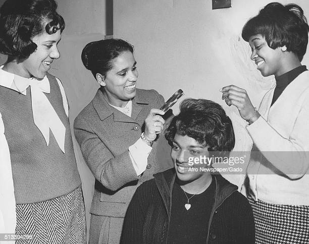 Marguerite Belafonte giving a hairstyling demonstration at Morgan State University Baltimore Maryland January 23 1965