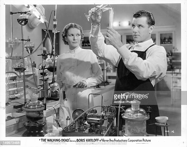 Marguerite Churchill and Warren Hull in lab together in a scene from the film 'The Walking Dead' 1936