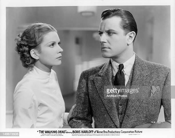 Marguerite Churchill grabbing Warren Hull in a scene from the film 'The Walking Dead' 1936