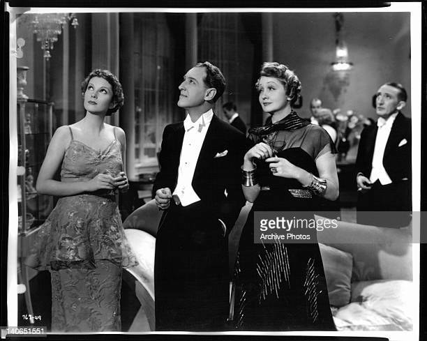 Marguerite Churchill Otto Kruger and other guests look up towards the ceiling at a formal party in a scene from the film 'Dracula's Daughter' 1936