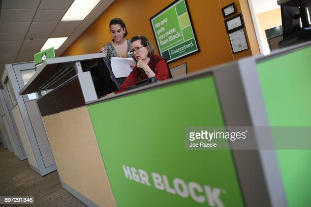 Marguerite Salmon HR Block Tax Specialist and Yisel Yanes work in the HR block office on the day President Donald Trump signed the Republican tax cut...