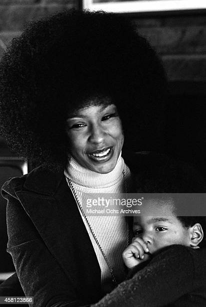 Marguerite Simpson, wife of O. J. Simpson, poses for a portrait at home on while holding her son Jason on January 8, 1973 in Los Angeles, California.