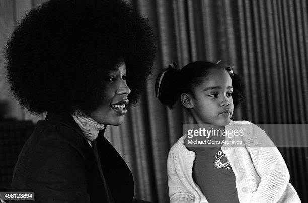 Marguerite Simpson wife of O J Simpson poses for a portrait at home while sitting next to her daughter Arnelle on January 8 1973 in Los Angeles...